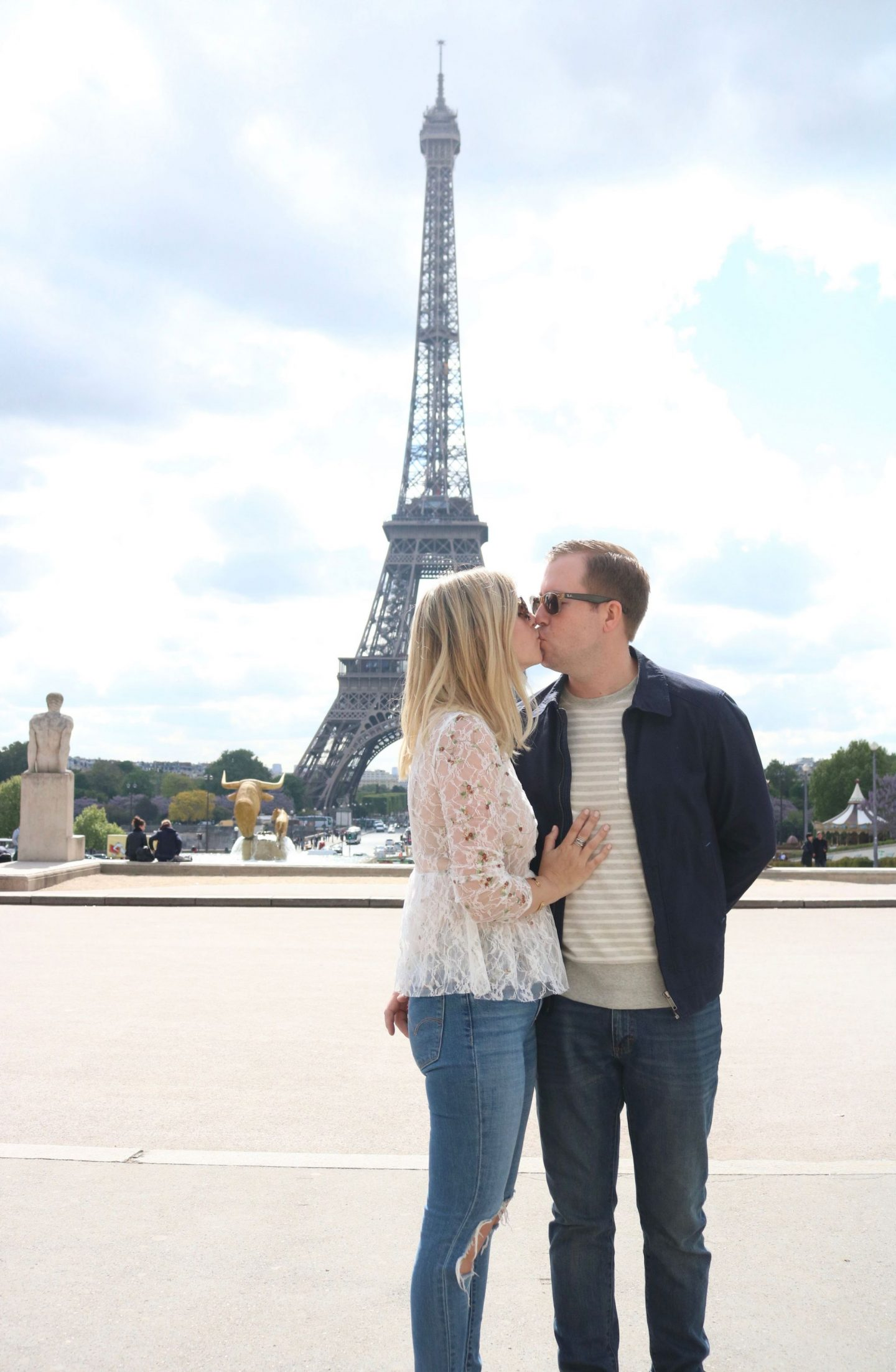 couple in paris, eiffel tower, distressed denim
