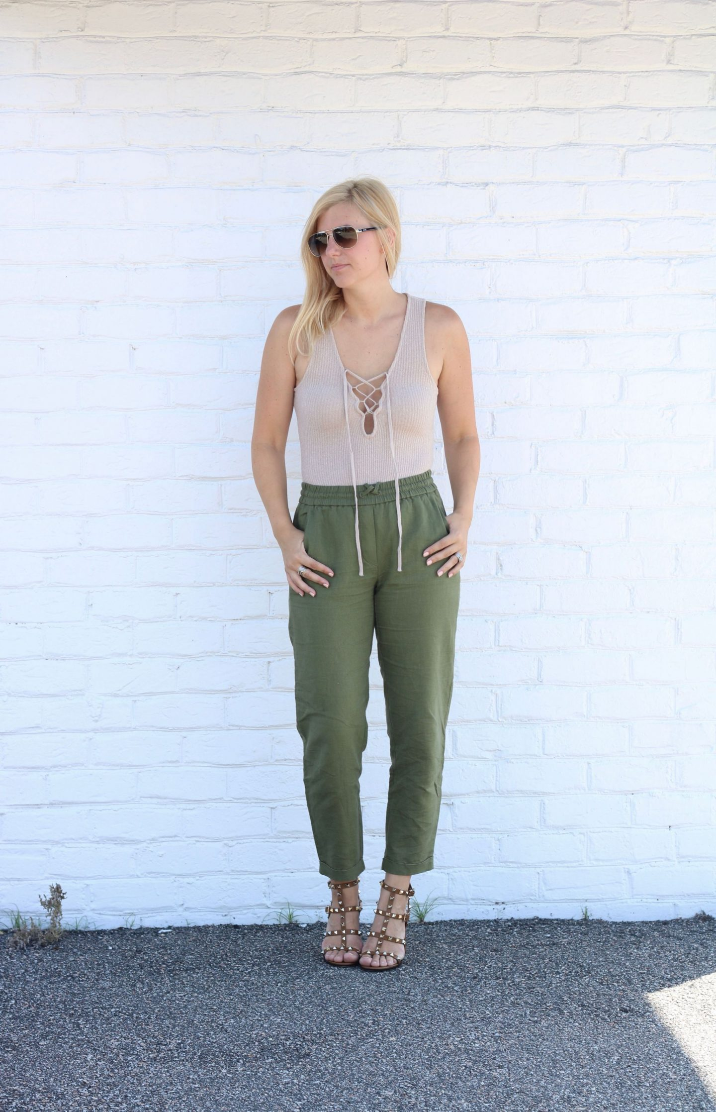 j.crew-linen-pants, lace-up-bodysuit, aviator-sunglasses, valentino-rockstud-heels