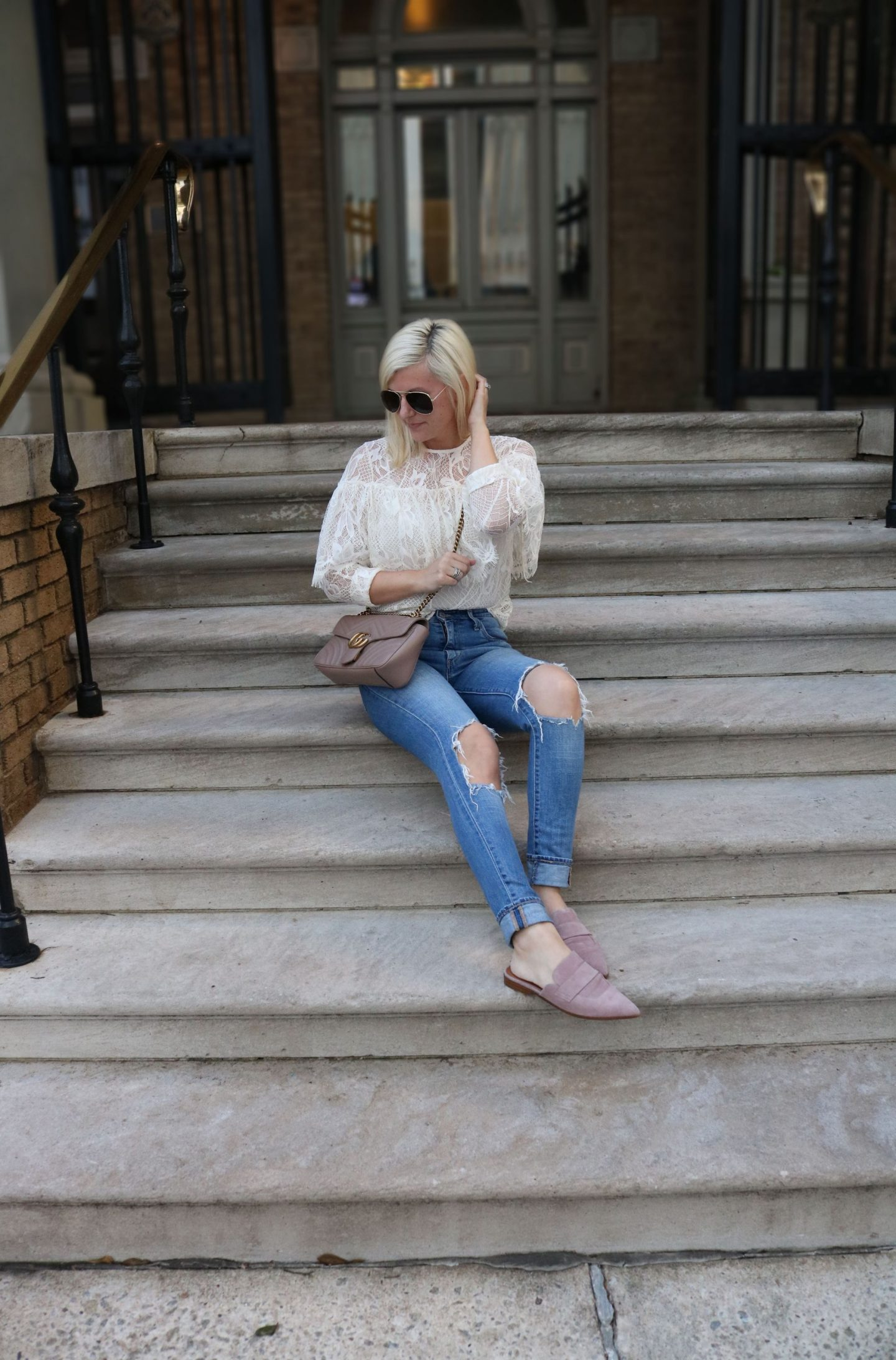 lace top and distressed denim, how to style the gucci handbag