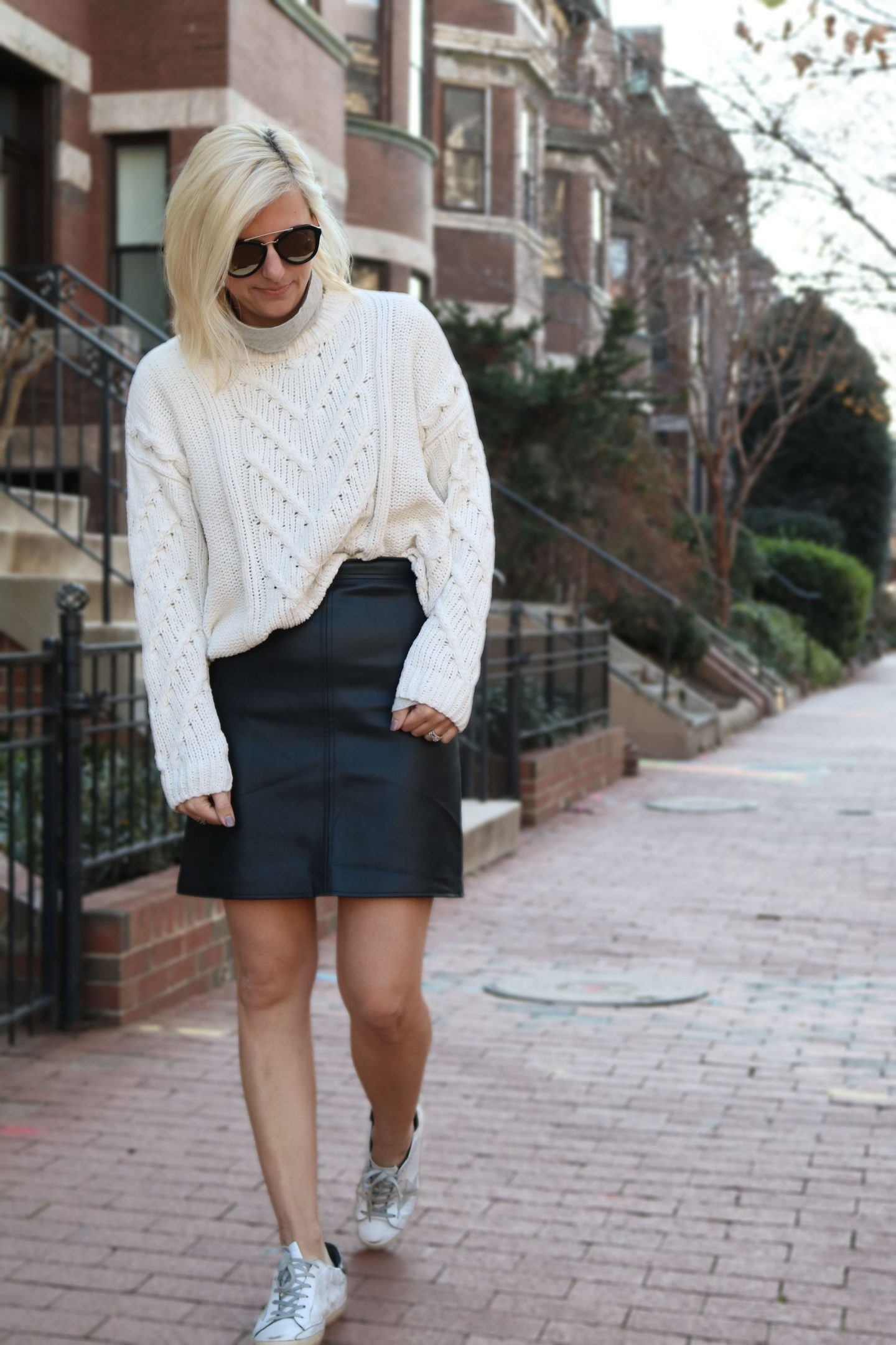 how to wear a leather skirt, leather skirt, oversized sweater, golden goose sneakers